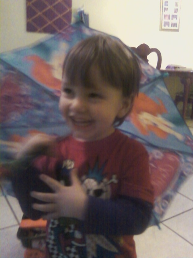 He's singing in the rain, just for mommy!